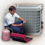 A technician working on an outdoor AC unit