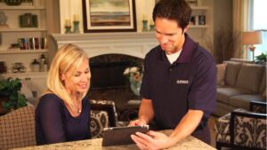 Air Specialist Heating Repair Tech with Houston Homeowner